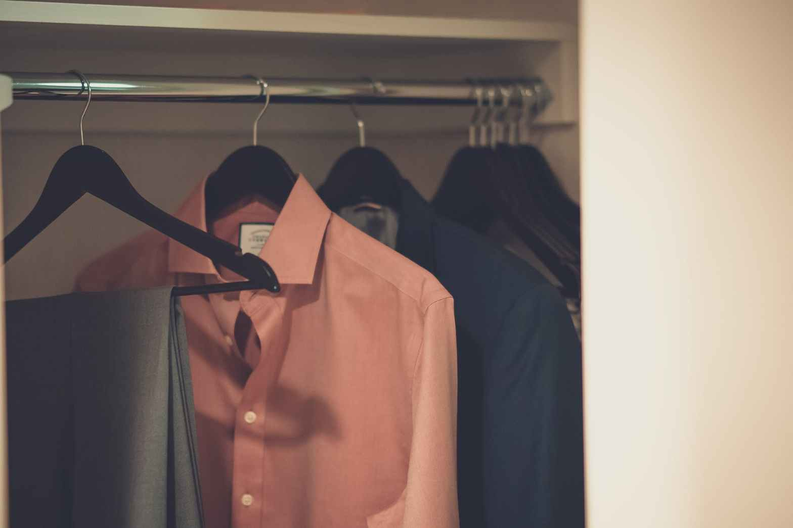 close up photo of hang clothes in wardrobe